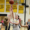 Record-Eagle/Keith King<br /> Traverse City Central's Katie Knudsen puts up a shot against Traverse City St. Francis Tuesday, February 14, 2012 at Traverse City Central High School.
