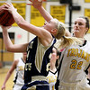 Record-Eagle/Keith King<br /> Traverse City St. Francis' Megan Knudsen puts up a shot against Traverse City Central's Molly Walker Tuesday, February 14, 2012 at Traverse City Central High School.