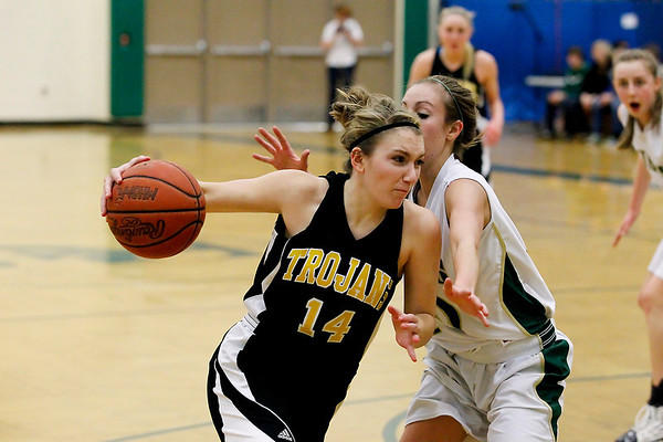Record-Eagle/Jan-Michael Stump<br /> Traverse City Central's Madi Bankey (14) drives past Traverse City West's Abby Howard (10) in the first quarter of Friday's game.