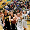 Record-Eagle/Jan-Michael Stump<br /> Traverse City Central's Molly Walker (22) steals a rebound from Traverse City West's Alexis Zywicki (31) in the fourth quarter of Friday's game.