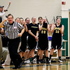 Record-Eagle/Jan-Michael Stump<br /> Traverse City Central players celebrate after a Trojan basket during Friday's win at Traverse City West.