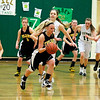 Record-Eagle/Jan-Michael Stump<br /> Traverse City Central's Chandler Cobb (5) pushes the ball upcourt after a Traverse City West turnover in Friday's game.