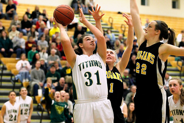 Record-Eagle/Jan-Michael Stump<br /> Traverse City West's Alexis Zywicki (31) shoots over Traverse City Central's Molly Walker (22) and Brianna Podsaid (1) in the second half of Friday's game.