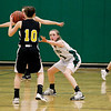 Record-Eagle/Jan-Michael Stump<br /> Traverse City West's Katie Placek (11) defends Traverse City Central's Katie Knudsen (10) in the second half of Friday's game.