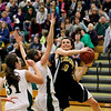 Record-Eagle/Jan-Michael Stump<br /> Traverse City Central's Katie Knudsen (10) shoots over Traverse City West's Shaina Streeter (15) and Alexis Zywicki (31) in the first half of Friday's game.