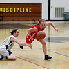 Record-Eagle/Jan-Michael Stump<br /> Marquette's Liana Storm (22) steals the ball from Traverse City Central's Katie Knudsen (10) and Chandler Cobb (5) in the third quarter of  Wednesday's district semifinal.