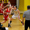 Record-Eagle/Jan-Michael Stump<br /> Traverse City Central's Molly Walker (22) defends Marquette's Alyssa Lindberg (24) in the first quarter of Wednesday's district semifinal.