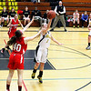 Record-Eagle/Jan-Michael Stump<br /> Traverse City Central's Brianna Podsaid (1) tip a pass away from Marquette's Hunter Vitala (40) in the second quarter of Wednesday's district semifinal.