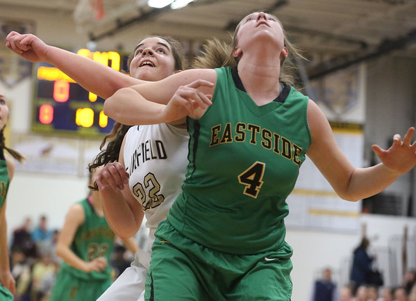 JAY YOUNG | THE GOSHEN NEWS Fairfield junior Katie Lashley (22) fights for rebounding position against Eastside junior Olivia Yoder (4) during their quarterfinal game in the NECC Basketball Tournament Wednesday night at Fairfield.