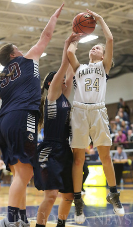 JAY YOUNG | THE GOSHEN NEWS<br /> Fairfield junior Felicity Bontrager (24) shoots over Garrett defenders Camden Bodey (50) and Hannah Sobieski during their game Tuesday night at Fairfield.