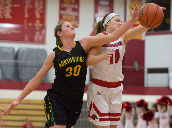 JAY YOUNG | THE GOSHEN NEWS<br /> Northridge senior Marci Miller (30) and Goshen High sophomore Josie Walters (10) fight for control of a rebound during the first half of their game Friday night at GHS.