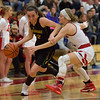 JAY YOUNG | THE GOSHEN NEWS<br /> Northridge senior Julaine Miller (12) uses her off hand to create space between herself and Goshen High junior Jillian Kissinger as she drives the ball during their game Friday night at GHS.