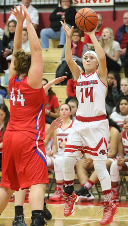 JAY YOUNG   THE GOSHEN NEWS<br /> Goshen senior Aylissa Trosper (14) fires off a three in front of West Noble junior Kasia Weigold (44) during their game Tuesday evening at GHS.