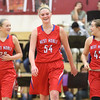 JAY YOUNG | THE GOSHEN NEWS<br /> West Noble players Kristina Teel (32), Kaylie Warble (54) and Angela Gross (42) are all smiles as they walk to their end of the court for free throws during the closing seconds of the fourth quarter of their game against Goshen High on Tuesday evening at GHS.