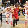 JAY YOUNG | THE GOSHEN NEWS<br /> West Noble sophomore Lauren Burns (10) pushes off of Goshen High senior Aylissa Trosper (14) as they chase after a loose ball during their game Tuesday evening at GHS.