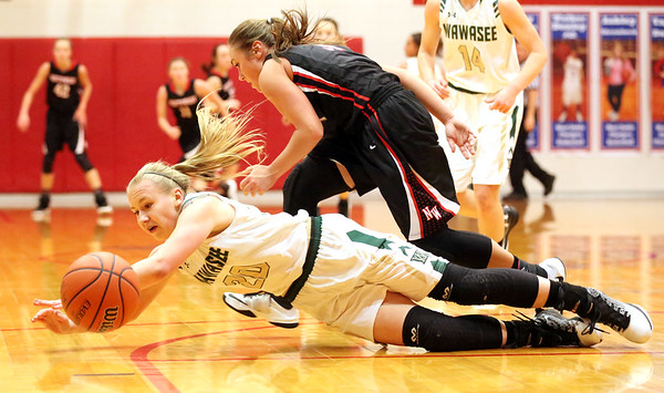 JAY YOUNG | THE GOSHEN NEWS<br /> NorthWood junior Savannah Feenstra, right, looks to drive past Wawasee senior Seaquinn during their sectional game Tuesday night at West Noble High in Ligonier.