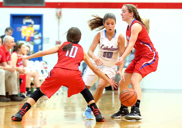 JAY YOUNG | THE GOSHEN NEWS<br /> Lakeland junior Karley Alleshouse, center, dribbles out of a double team by West Noble's Lauren Burns (10) and Tori Miller, right, during their sectional game Tuesday night in Ligonier.