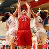 JAY YOUNG | THE GOSHEN NEWS<br /> West Noble senior Kaylie Warble (54) fights with Lakeland's Rebeka Stroop (12) and Jaden Conard (34) for control of a rebound during their sectional game Tuesday night in Ligonier.