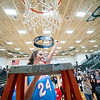 Lakeland forward Baily Hartsough (24) reacts after cutting the net after Saturday's game at Wawasee High School in Syracuse.