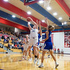 West Noble Chargers senior Taytlynn Forrer (34) shoots a basket during Thursday's game at West Noble High School in Ligonier.