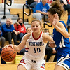 West Noble Chargers senior Erin Shoemaker (10) dribbles the ball down court against Bethany Christian Bruins senior Mia Reinhardt (12) during Thursday's game at West Noble High School in Ligonier.