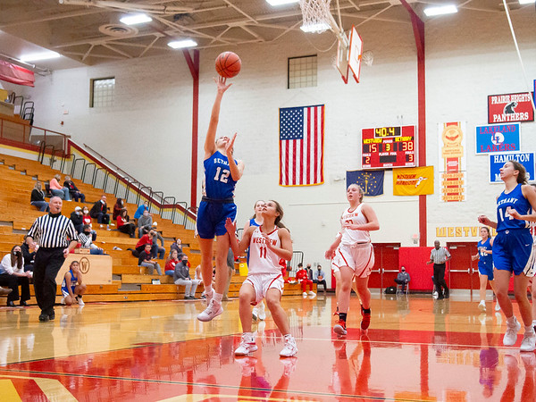 Bethany Christian Bruins senior Mia Reinhardt (12) goes up for a basket against Westview Warriors senior Erika Miller (11) during Tuesday's game at Westview Junior-Sr. High School in Topeka.