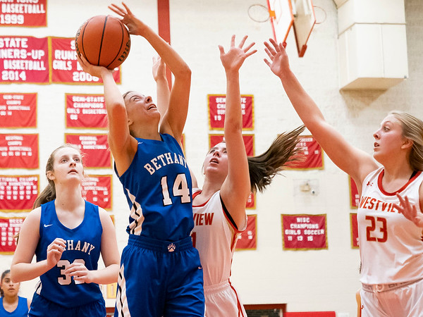 Bethany Christian Bruins senior Sadie Brenneman (14) goes up for a basket during Tuesday's game at Westview Junior-Sr. High School in Topeka.