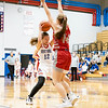 Goshen RedHawks senior Megan Gallagher (14) guards West Noble Chargers senior sophomore Mackensy Mabie (12)  during Tuesday's game at West Noble High School in Ligonier.