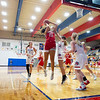 Goshen RedHawks senior Brynn Shoup-Hill (23) shoots a basket against West Noble Chargers senior Lillian Mast (24) during Tuesday's game at West Noble High School in Ligonier.