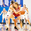 Goshen RedHawks senior Megan Gallagher (14) battles for the ball against West Noble Chargers senior Lillian Mast (24) during Tuesday's game at West Noble High School in Ligonier.