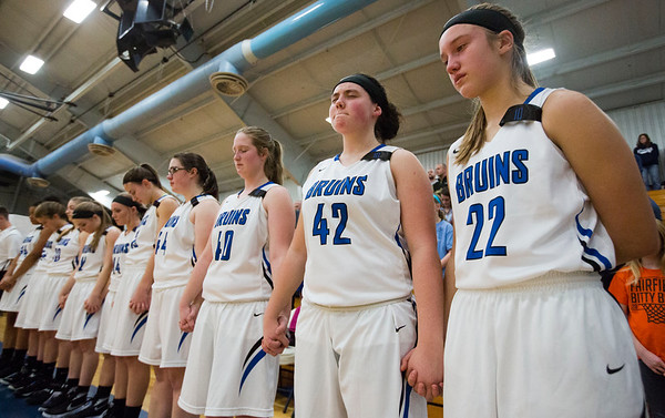 JAY YOUNG | THE GOSHEN NEWS<br /> Bethany Christian players including freshman Jadyn Kaufmann (22) and Mariah Miller (42) hold hands during a moment of silence for teammate Anna Barnard on Tuesday evening before the start of their game against Concord on Tuesday night at Bethany. Barnard was killed in a car accident on Sunday.