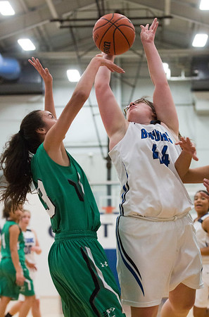 JAY YOUNG | THE GOSHEN NEWS<br /> Bethany Christian senior Megan Duckworth (44) gets off a shot over Concord sophomore Riley Mathewson (3) during their game Tuesday night at Bethany.