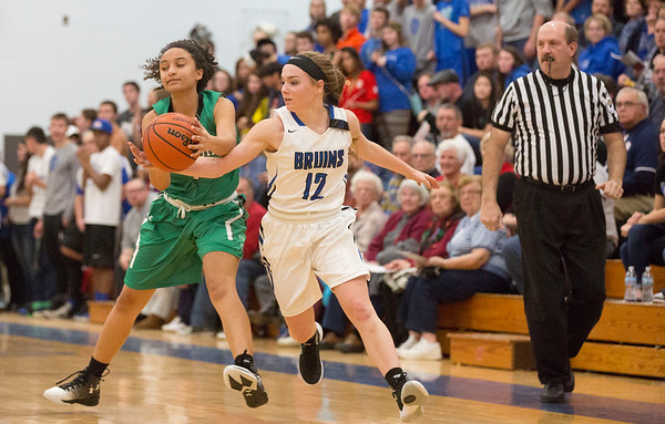 JAY YOUNG | THE GOSHEN NEWS<br /> Bethany Christian junior Tarynn Clark (12) tries to swipe the ball away from Concord junior Jenica Albert during their game Tuesday night at Bethany.