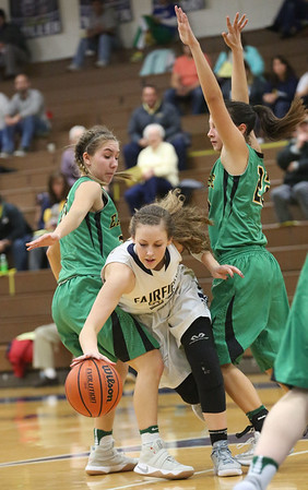 JAY YOUNG   THE GOSHEN NEWS<br /> Fairfield junior Jenean Schwartz, center, dribbles out of a double team by Eastside defenders Hannah Yoder, left, and Maddisyn Heffley, right, during their quarterfinal game in the NECC Basketball Tournament Wednesday night at Fairfield.
