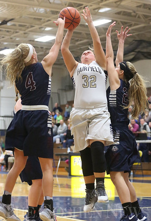 JAY YOUNG | THE GOSHEN NEWS<br /> Fairfield senior Alexis Thaxton (32) gets between Garrett defenders Drue Bodey (4) and Hannah Sobieski as she gets a shot off during their game Tuesday night at Fairfield.