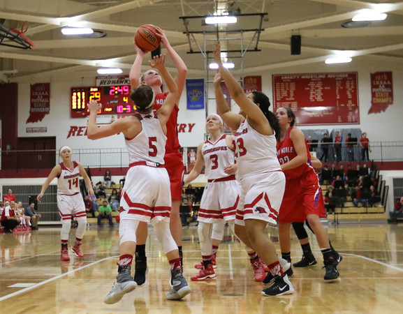 JAY YOUNG | THE GOSHEN NEWS<br /> West Noble senior Kaylie Warble gets off a shot in traffic as she is surrounded by Goshen defenders Ashton Ellis (5), Jillian Kissinger (3) and Nyla Dean (23) during their game Tuesday evening at GHS.
