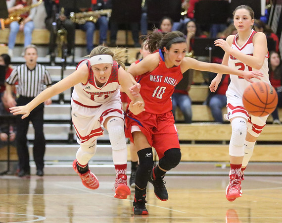 JAY YOUNG   THE GOSHEN NEWS<br /> West Noble sophomore Lauren Burns (10) pushes off of Goshen High senior Aylissa Trosper (14) as they chase after a loose ball during their game Tuesday evening at GHS.