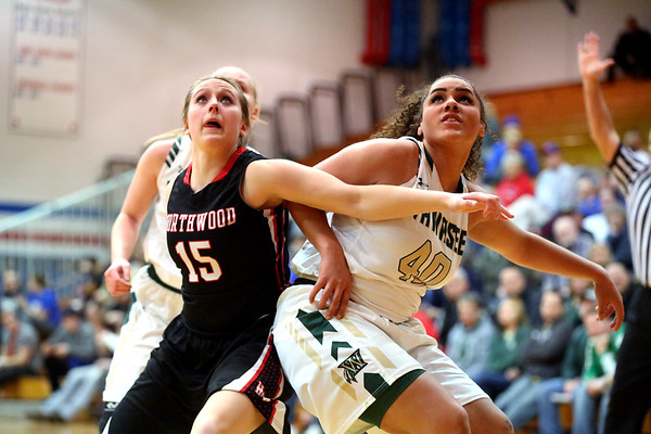JAY YOUNG | THE GOSHEN NEWS<br /> NorthWood senior Nicole Flickinger (15) and Wawasee senior Seaquinn Bright (40) fight for rebounding position during their sectional game Tuesday night at West Noble High in Ligonier.