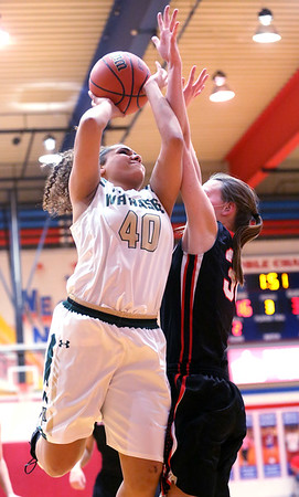 JAY YOUNG | THE GOSHEN NEWS<br /> Wawasee senior Seaquinn Bright (40) draws contact as shoots over NorthWood junior Savannah Feenstra  during their sectional game Tuesday night at West Noble High in Ligonier.
