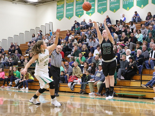 JAY YOUNG | THE GOSHEN NEWS<br /> Wawasee senior Hannah Haines (22) launches a three point shot over Northridge junior Meghan Cawood (32) during their game Tuesday night at Northridge Middle School.