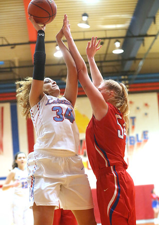 JAY YOUNG | THE GOSHEN NEWS<br /> Lakeland senior Jaden Conard (34) shoots over West Nobel senior Kaylie Warble during their sectional game Tuesday night in Ligonier.