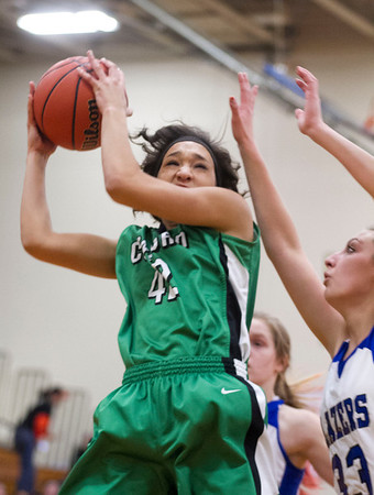 SAM HOUSEHOLDER | THE GOSHEN NEWS<br /> Concord senior Michelle Detwiler grabs a rebound during the sectional game against Elkhart Central Tuesday at Northridge High School