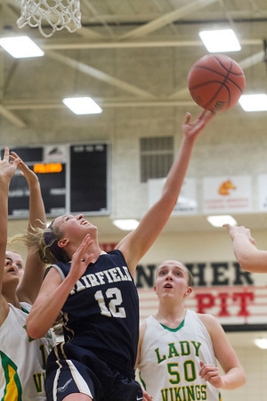 SAM HOUSEHOLDER | THE GOSHEN NEWS<br /> Fairfield junior Katie Yates shoots over Tippecanoe Valley players Wednesday during the 3A Sectional game at NorthWood High School.