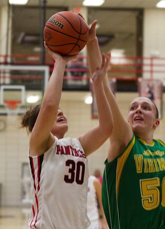 SAM HOUSEHOLDER   THE GOSHEN NEWS<br /> NorthWood junior Ashley Yoder shoots the ball against Tippecanoe Valley Friday during the 3A Sectional Semifinal game.