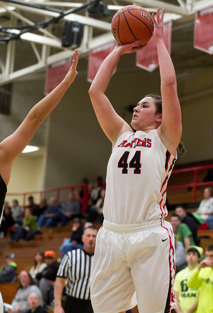 SAM HOUSEHOLDER | THE GOSHEN NEWS<br /> NorthWood senior Morgan Olson shoots during the game against Wawasee Wednesday during the 3A Sectional game at NorthWood High School.