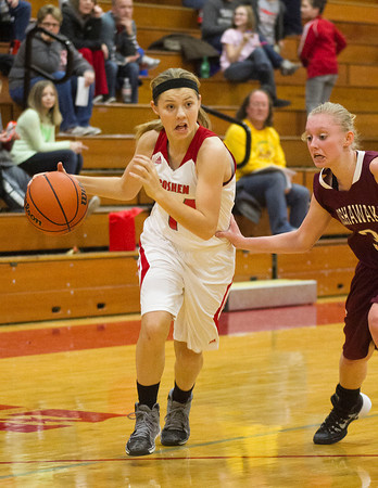 SAM HOUSEHOLDER | THE GOSHEN NEWS<br /> Goshen freshman Aylissa Trosper dribbles the ball during the game against Mishawaka Tuesday.