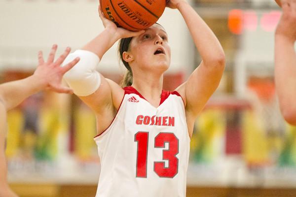 SAM HOUSEHOLDER   THE GOSHEN NEWS<br /> Goshen junior Alyssa Hershberger shoots the ball against Mishawaka Marian Tuesday.