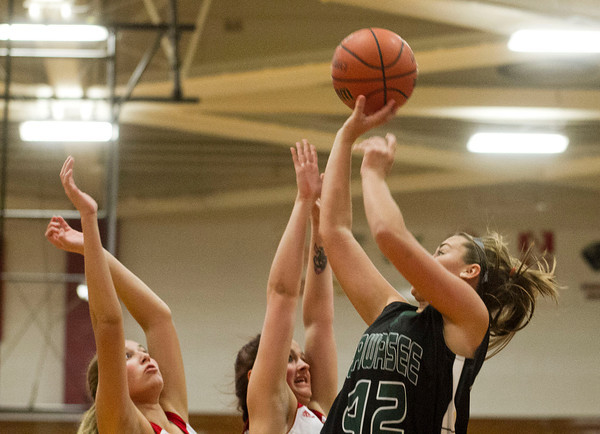 SAM HOUSEHOLDER | THE GOSHEN NEWS<br /> Wawasee's Aubrey Schmeltz shoots over Goshen players Leslie Vanlandingham, center and Kayci Troyer, left during the game Friday.