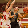 SAM HOUSEHOLDER | THE GOSHEN NEWS<br /> Wawasee sophomore Kylee Rostochak shoots over Goshen defender Leslie Vanlandingham Friday during the game.