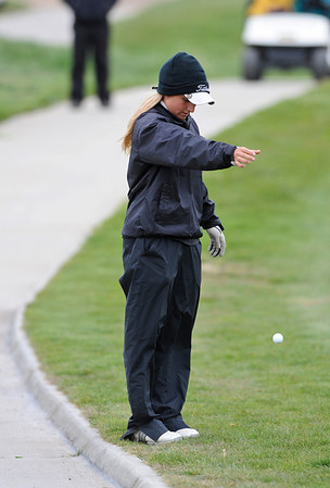 GOLF04<br /> Skyline's Mikayla Tatman takes a drop after hitting the ball onto the cart path at a state qualifier meet at Longmont's Ute Creek Golf Course on Tuesday.<br /> Photo by Marty Caivano/Camera/May 11, 2010
